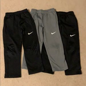 Three pairs of Nike Dri-Fit joggers